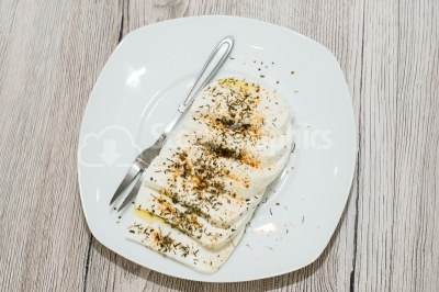 Cheese with herbs on white dish