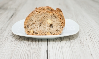 Slices of bread with seeds on wooden surface