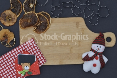 Baking background with dried fruits snow man, and kitchen tools