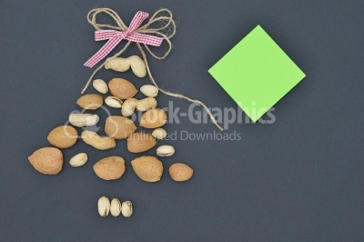 Mixed nuts on dark background looking like Christmas Tree