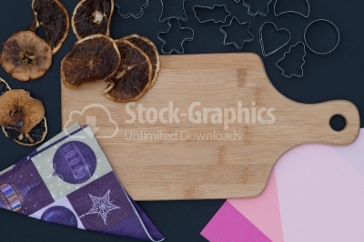 Baking background with dried fruits and christmas decoration