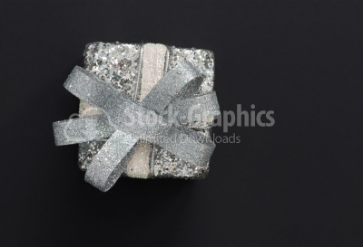 Top view of christmas gift box in silver wrapping paper