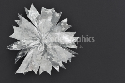 Silver bow decorations on a dark background