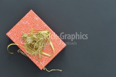 Christmas holiday gift box in spotted paper with gold