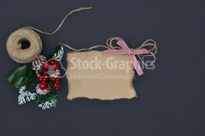 Close up of a note card with ribbon bow and christmas decoration