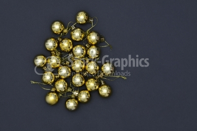 Gold Christmas Ornaments on Gray Background
