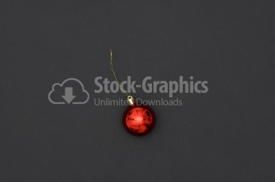 Red Christmas Bauble Tied Over Black Background