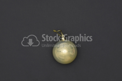 Yellow Christmas Bauble Tied Over Black Background
