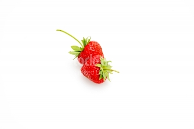 Strawberries with green leaves on white background