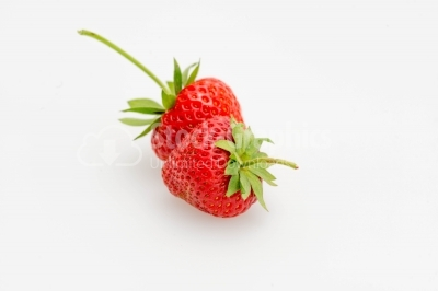 Strawberries with green leaves on white background close-up