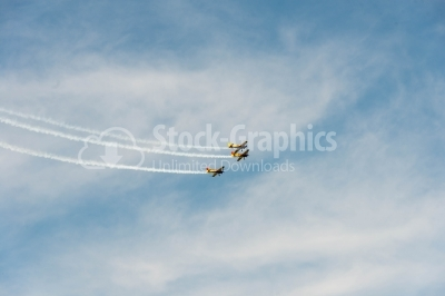 Propeller planes crossing the sky
