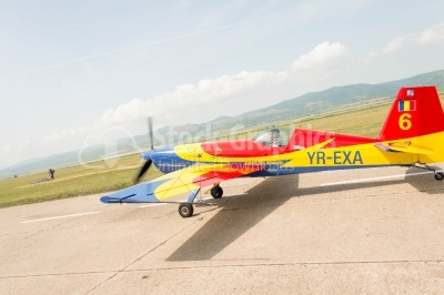 Romanian-flag-coloured propeller plane landing