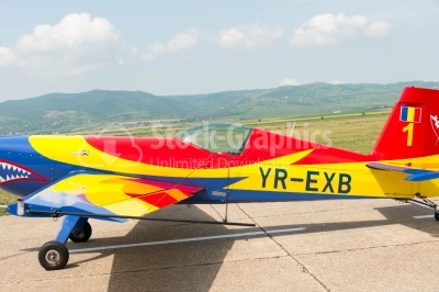 Sports romanian-flag colored plane landing