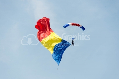 Flying on romanian parachute on the blue sky