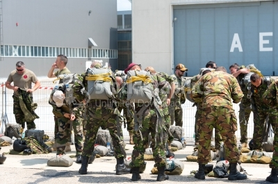 Military paratroopers preparing their bags for jumping