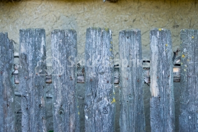 Wooden fence on old background