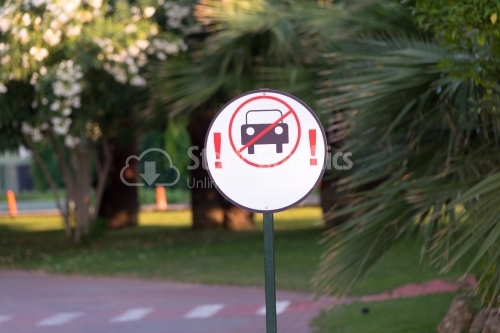 No vehicle red road sign surrounded by trees