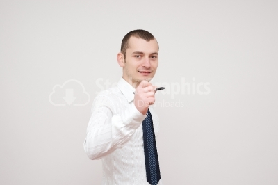 Young businessman holding a pen