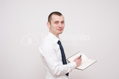 Young businessman with a notebook