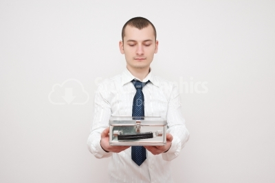 Young businessman looking at a box