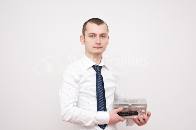 Young Man Carrying a Metal Box