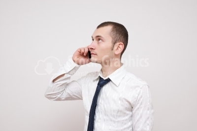 Young guy talking at the phone - Stock Image