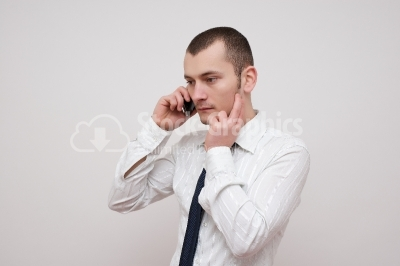 Worried Young businessman talking with the phone