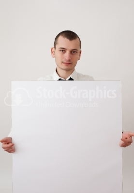 Businessman pointing at a placard
