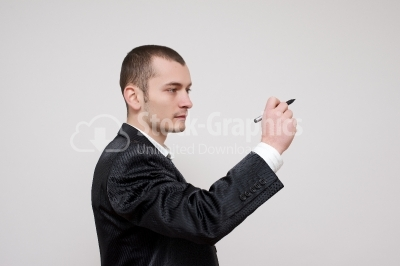 Young businessman drawing with a marker