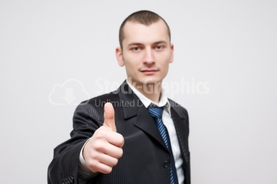 Businessman Gesturing Thumbs Up