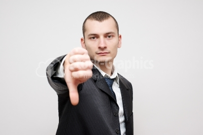 Close-up of a businessman gesturing thumbs down sign