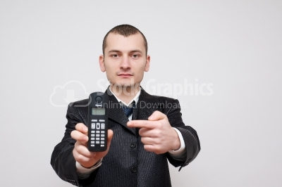 Businessman pointing on mobile phone