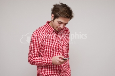 Guy texting on his smart phone