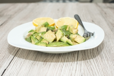 Avocado salad with lemon on white dish