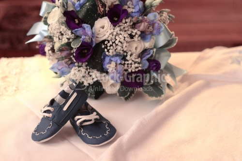 Baby shoes and floral arrangement