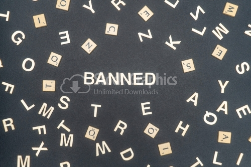 BANNED word written on dark paper background. BANNED text for your concepts