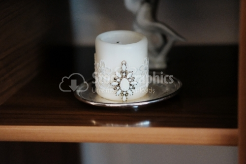 Baptismal delicate white candle wrapped with a ribbon cameo