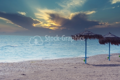 Beach with two umbrellas