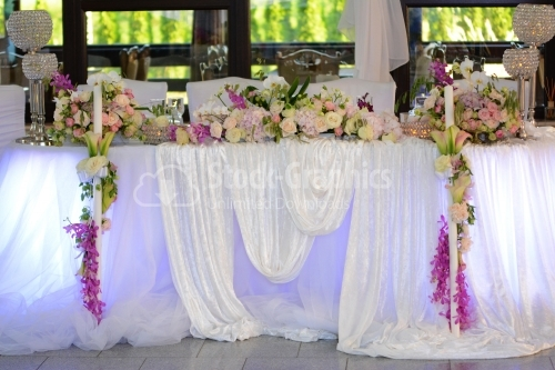 Big wedding table with lots of flowers and details