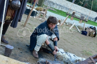 Blacksmith working on a medieval festival