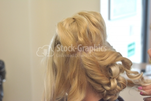 Blond woman curly hair detail