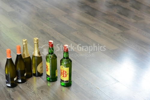 Bottles of wine, champagne and whiskey placed on the floor