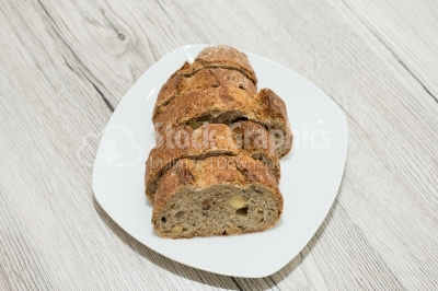 Bread cut sliced ​​on a white plate