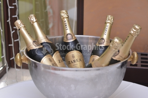 Bucket with bottles of champagne