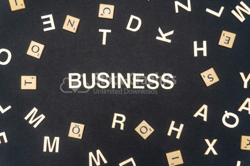 BUSINESS word written on dark paper background. BUSINESS text for your concepts
