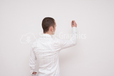 Businessman With Pen looking at the wall