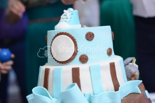 Cake covered with blue marzipan. Cake with blue boots on top