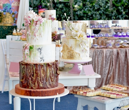Cake exhibition. Cakes, cake with gold foil and hand painted flowers
