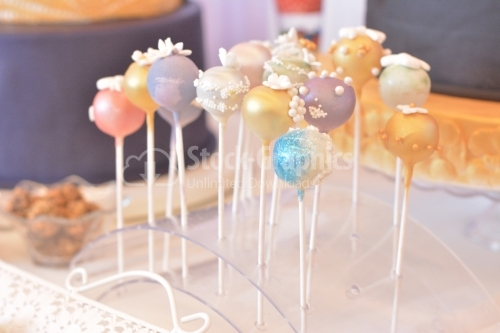 Cake pops with blue, purple and gold glitter