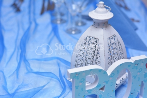Candle box on a blue tule